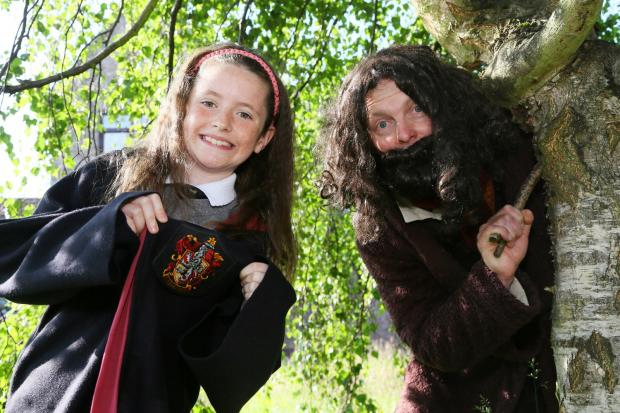 Nine-year-old Anna Shorten with Hagrid during the Harry Potter- themed walk to school