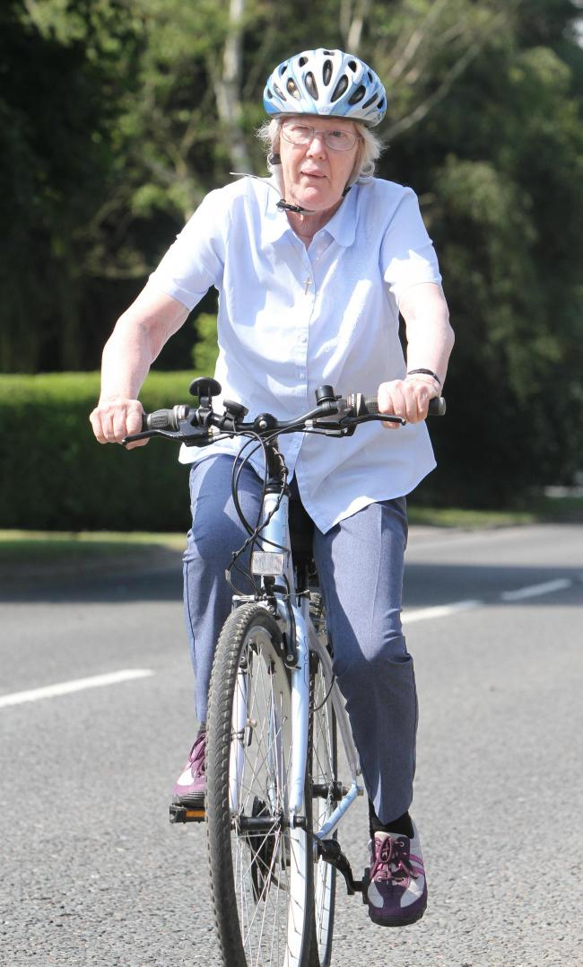 Parkinson's sufferer Val Loughborough of Barton preparing for her charity coast to coast cycle ride.