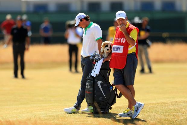 OUT OF FORM: Rory McIlroy appears dejected with his caddy JP Fitzgerald after enduring a poor first day at the Open Championship at Muirfield Golf Club