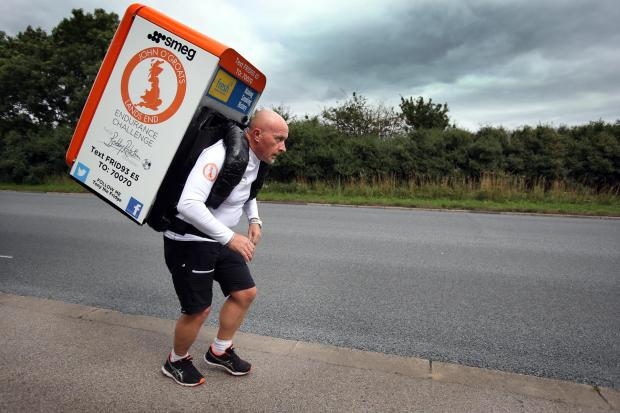 "The Northern Echo: Tony ""The Fridge"" Phoenix-Morrison makes his way along the A167 near Newton Aycliffe during his John O'Groats to Lands End charity run"