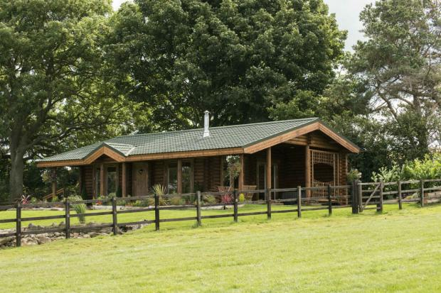 One of the luxury log cabins at Sun Hill Stables
