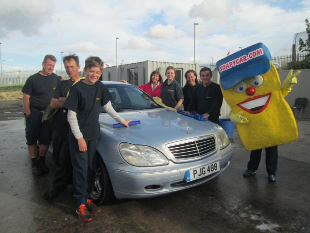 AT THE CAR WASH: The team at Soapycar.com raise money for cancer charity campaign