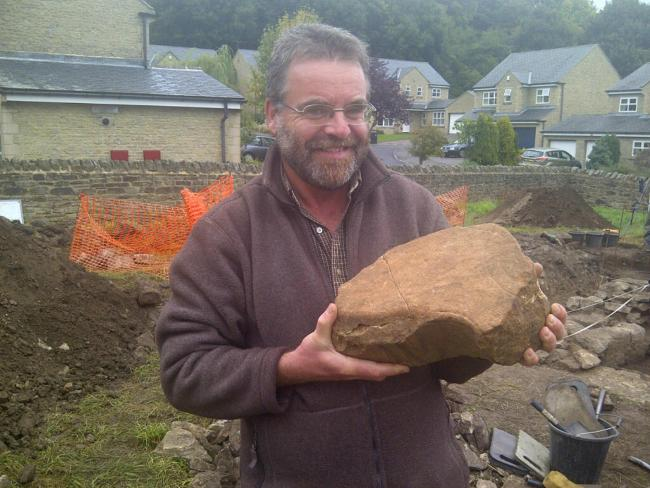 Paul Frodsham, of the AONB Partnership, shows off the section of an Anglo Saxon cross unearthed during a dig in Frosterley