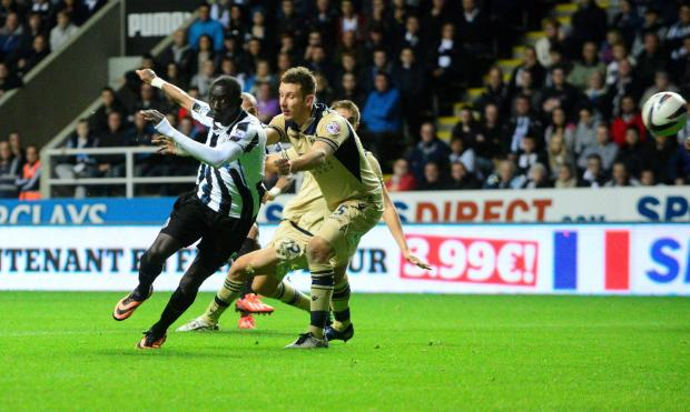 PROGRESS: Newcastle's Yoan Gouffran, partially hidden, fires in the second goal against Leeds