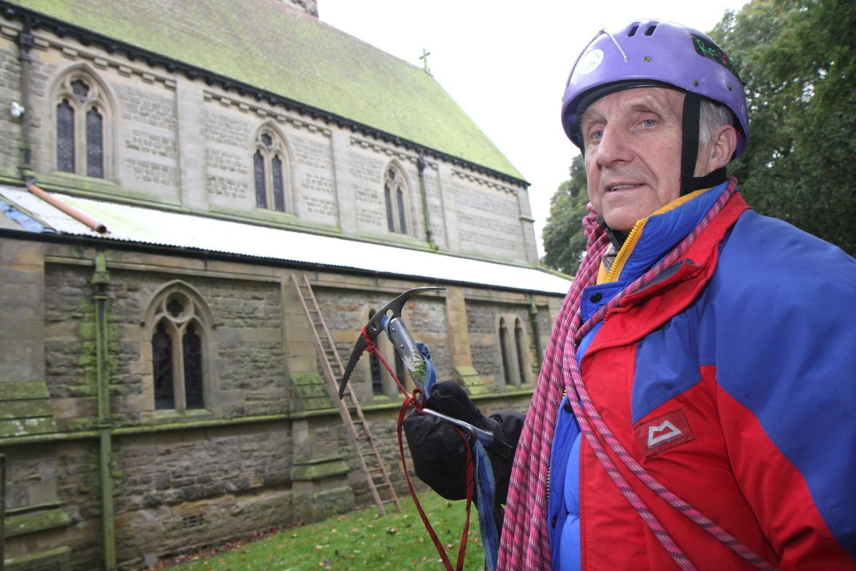 Church member Chris Brown looks at where the lead was stolen from the roof of St James' Church, Baldersby