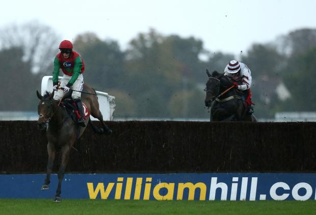 The Northern Echo: FIRST HOME: Dodging Bullets, ridden by Daryl Jacob, goes on to win the William Hill – In The App Store Beginners' Chase during the William Hill Jump Sunday at Kempton Park yesterday