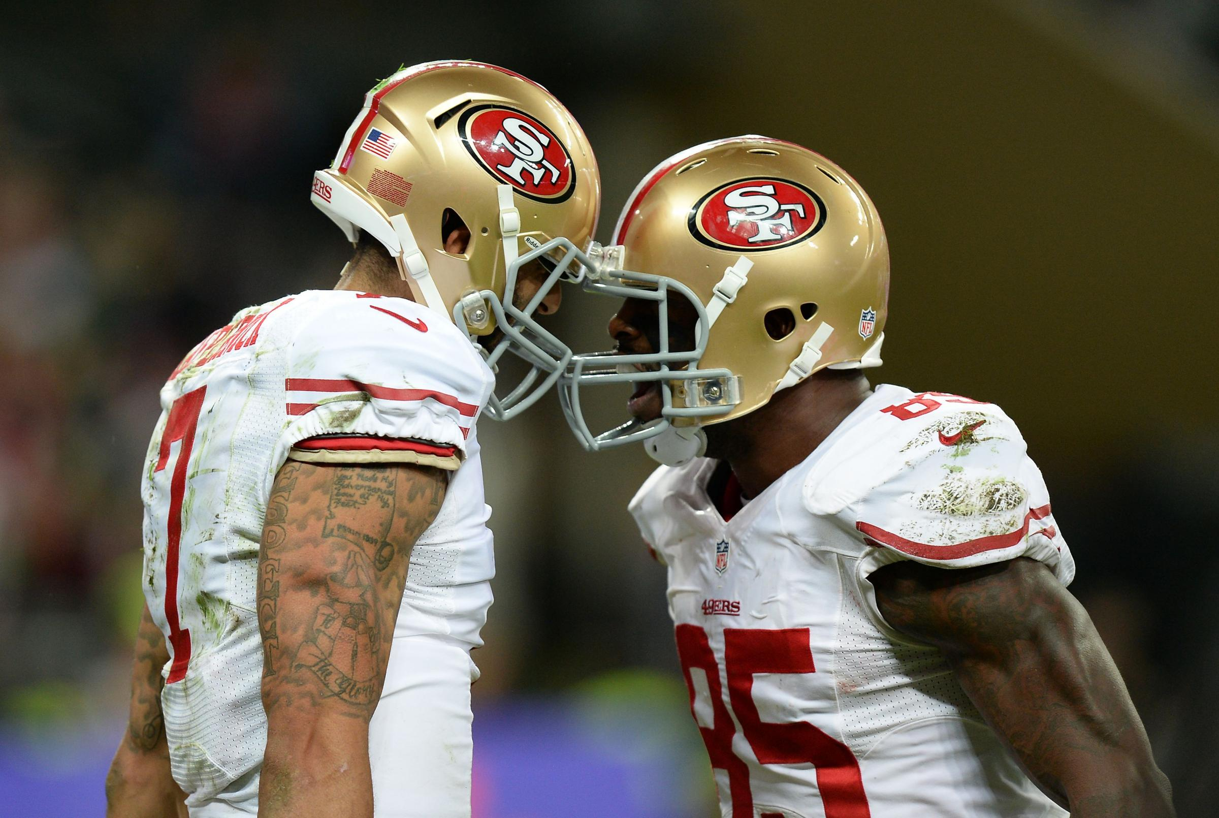 PARTY TIME: San Francisco 49ers' quarterback Colin Kaepernick celebrates with team-mate Vernon Davis after scoring his second touchdown