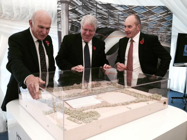 Transport Secretary Patrick McLoughlin, (centre) with Business Secretary Vince Cable and Alistair Dormer executive chairman of Hitachi Europe, with model of Hitachi train factory