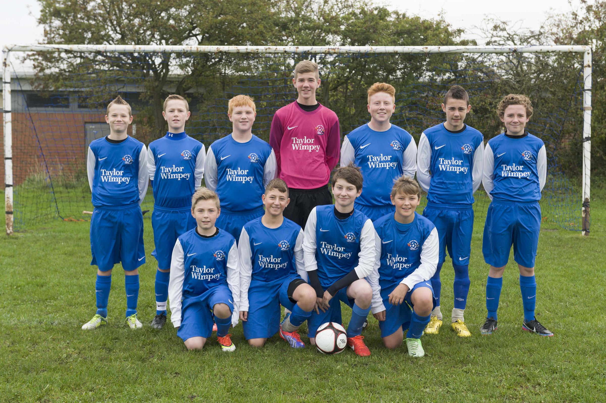 Youth team gives opponents the blues in newly-donated kit