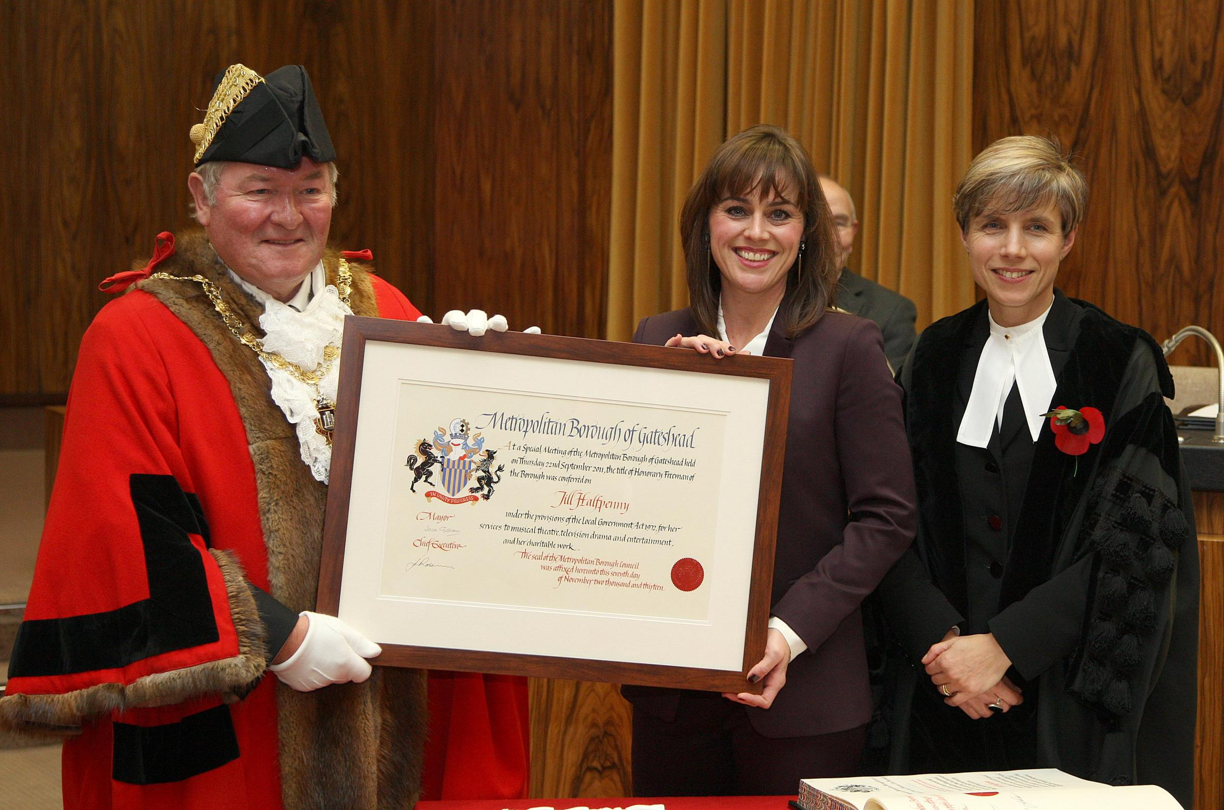 Actress Jill Halfpenny is awarded the Freedom of Gateshead by town mayor Jack Graham (left) and council chief executive Jane Robinson
