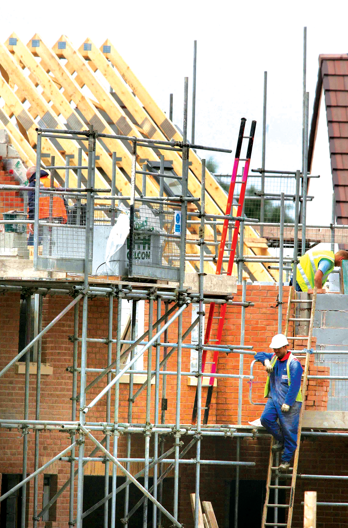 HOUSE PLANS: Builders at work on a housing development. Library image.