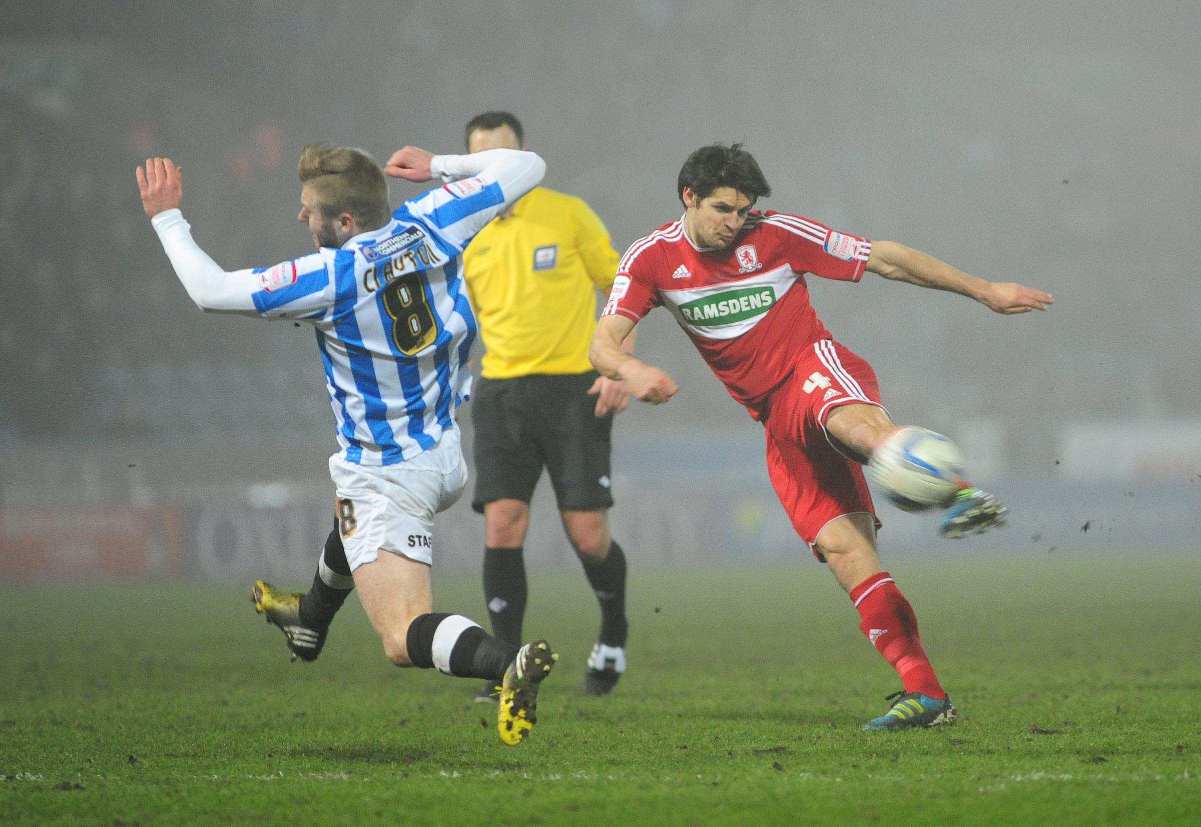 Huddersfield Town's Adam Clayton tries to block a shot from Middlesbrough's George Friend