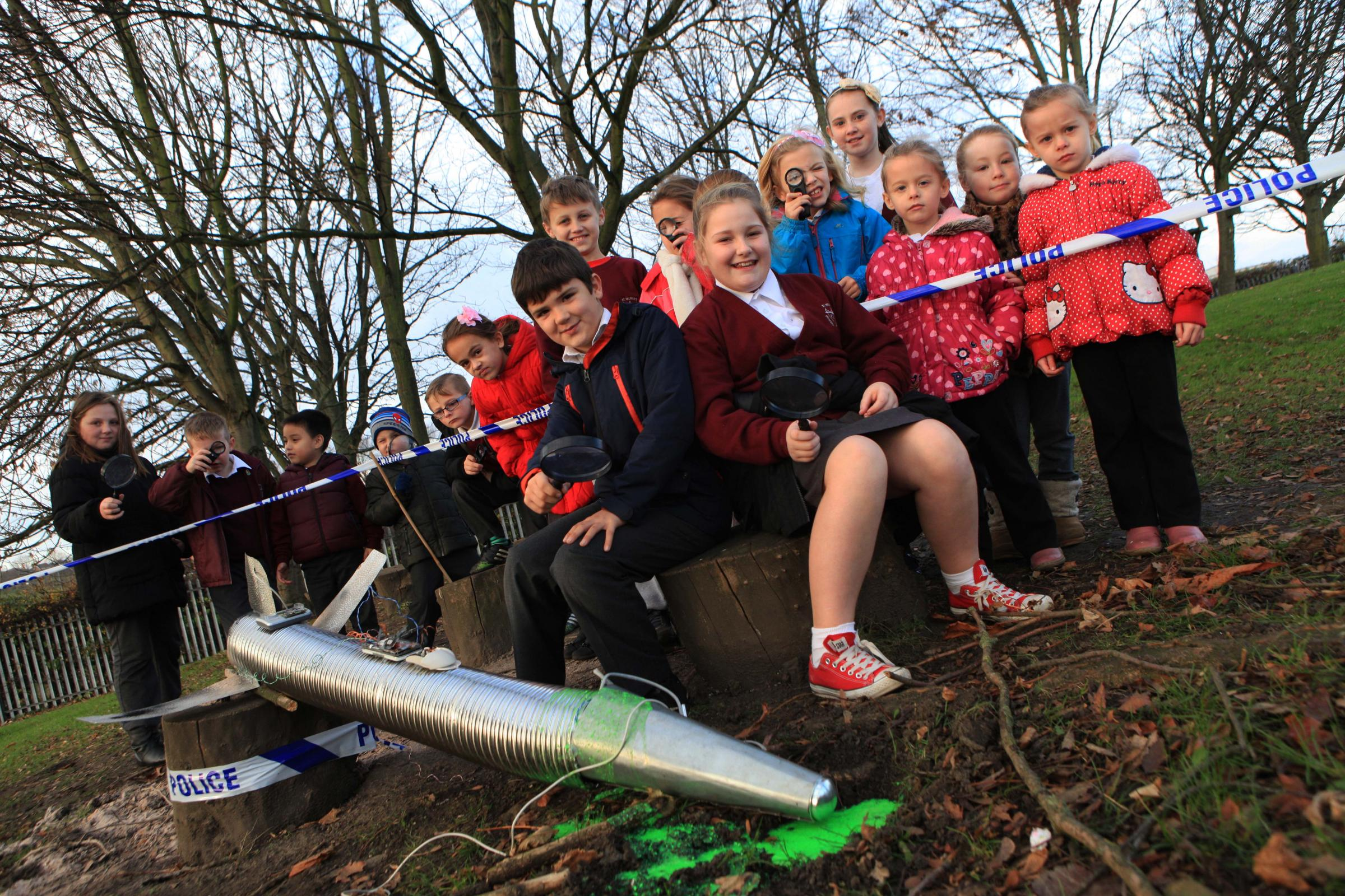 Pupils from St Wilfrid's RC Primary School, Bishop Auckland, investigate UFO crash landing in school field pictured front Nathan Slater, 9, and Olivia Thompson, 9.