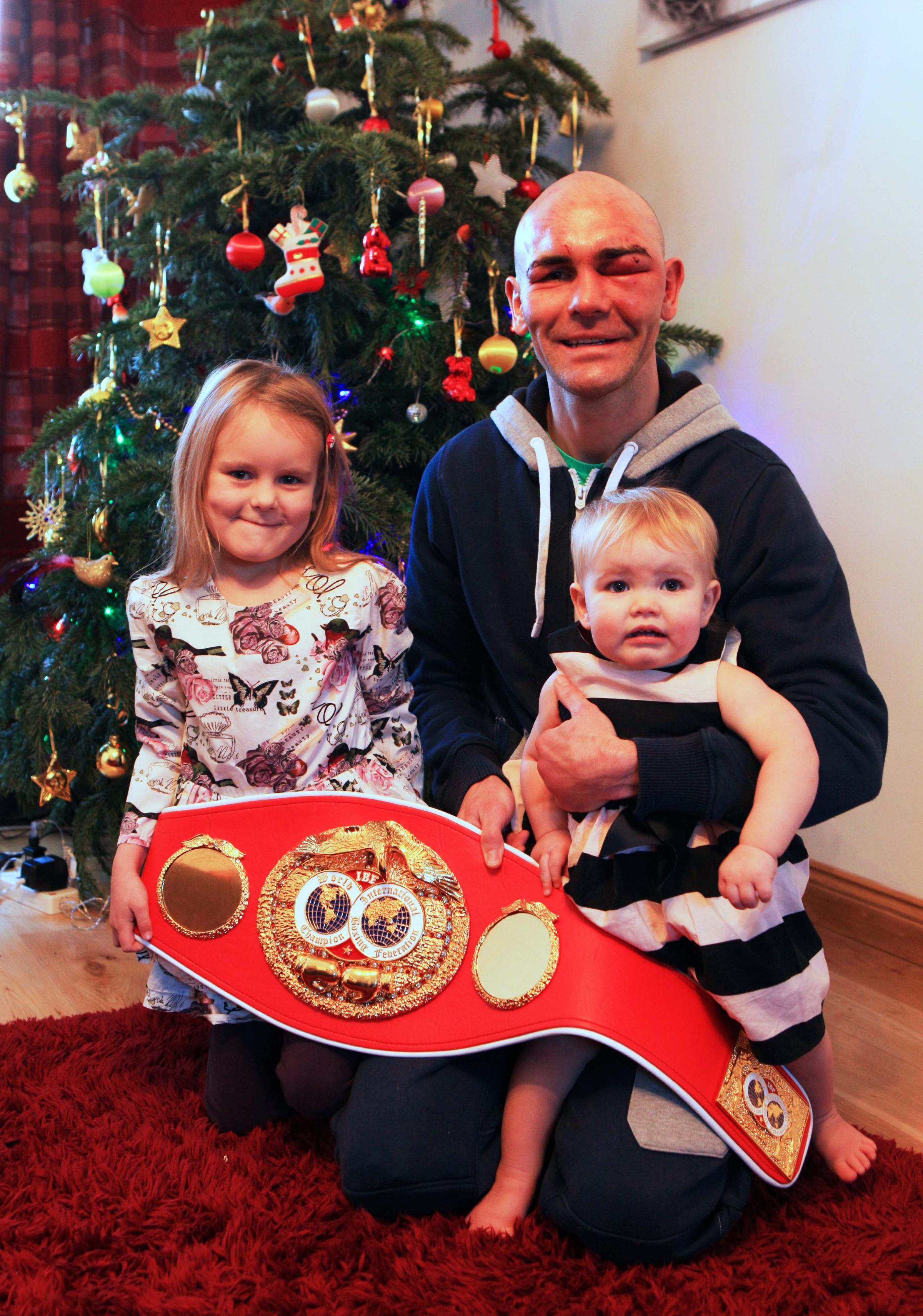 WINNING FEELING: Stuart Hall back home in Dalington after winning his fight last night. He is pictured with his children, Thea five, and 14-month-old Rio