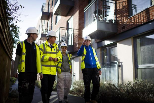Prime Minister David Cameron chats with apprentices at a new housing development. The Industry Apprentice Council says some apprentices don't feel they received enough career advice at school