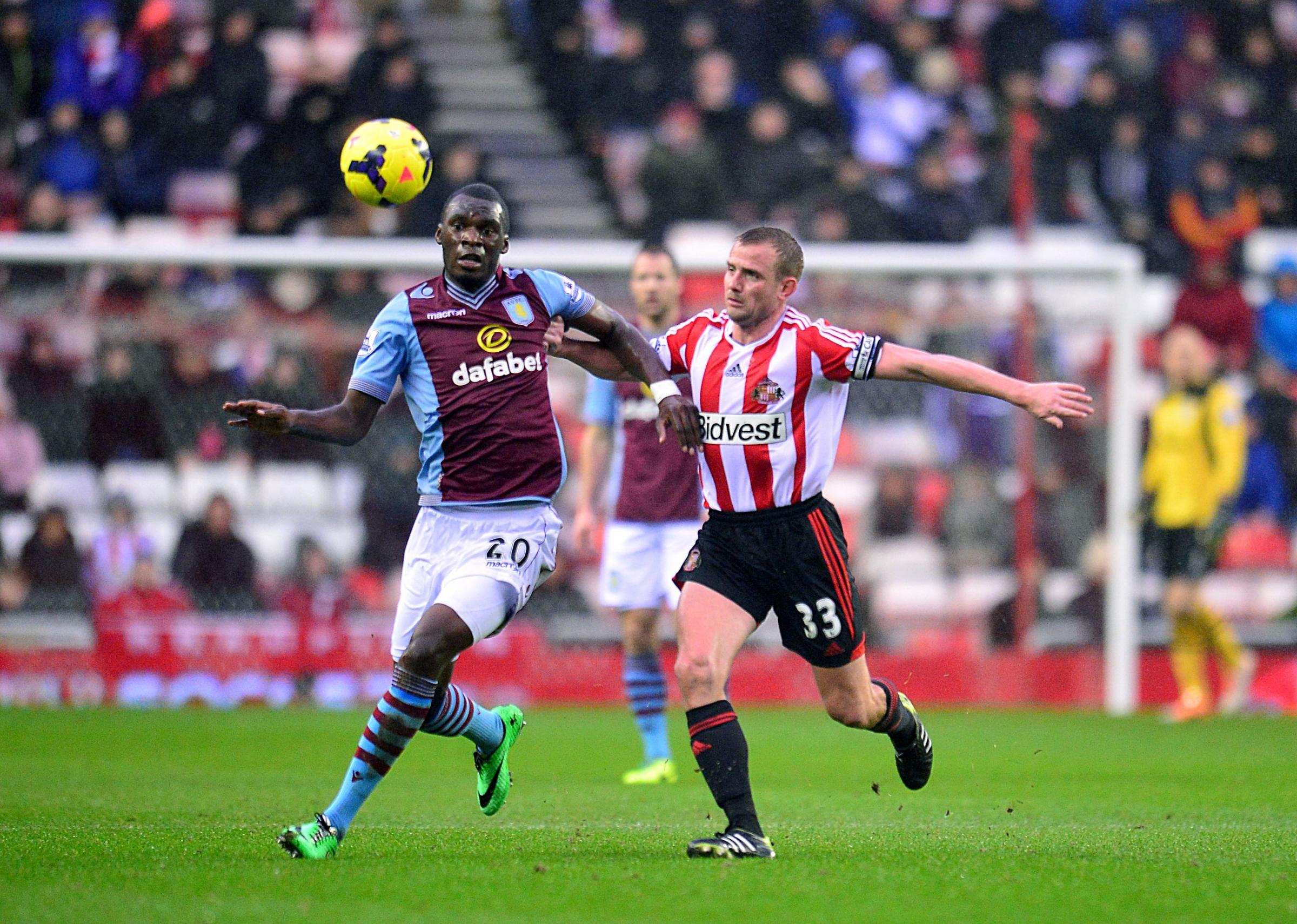 COSTLY: Sunderland's Lee Cattermole and Aston Villa's Christian Benteke battle for the ball during on Wednesday. Cattermole's mistake led to Villa scoring the only goal of the game
