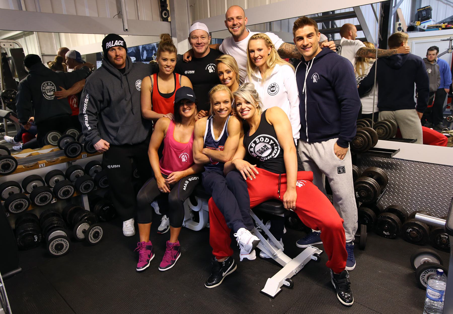 Mike Hind, pictured third from right on the back row, with staff and bodybuilders in the company's gym
