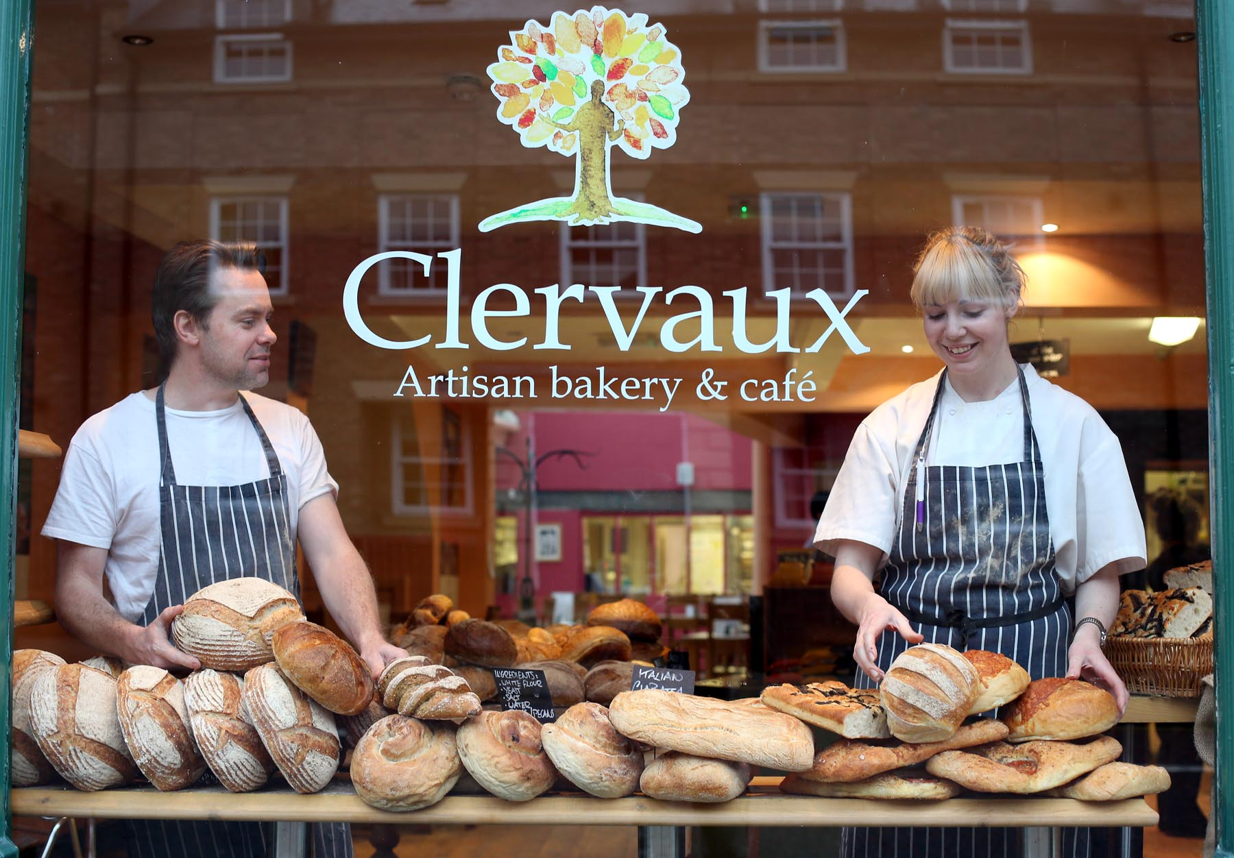 The Clervaux Bakery is to appear on a new television competition, Britain's Best Bakery.  Pictured in the shop window with a range of their produce are head baker Scott Hayward (left) and head chef Sam Ainsley (right)