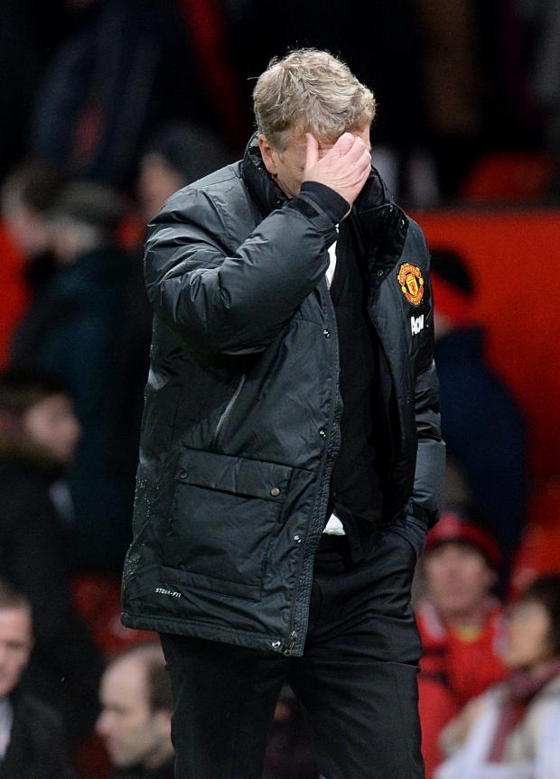The Northern Echo: ANOTHER BAD NIGHT: David Moyes was left dejected as Man United crashed out of the Capital One Cup at the hands of Sunderland