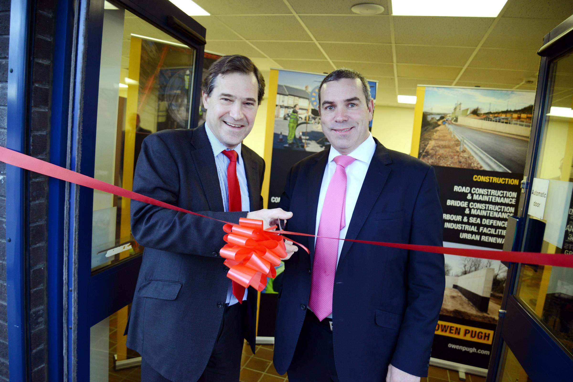 John Dickson, Owen Pugh Group chairman, left, with Andy Parker, HSBC senior corporate banking manager at the opening of the new depot