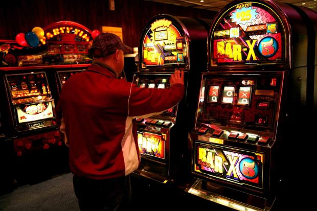 RAISING THE STAKES: A punter at a gambling machine