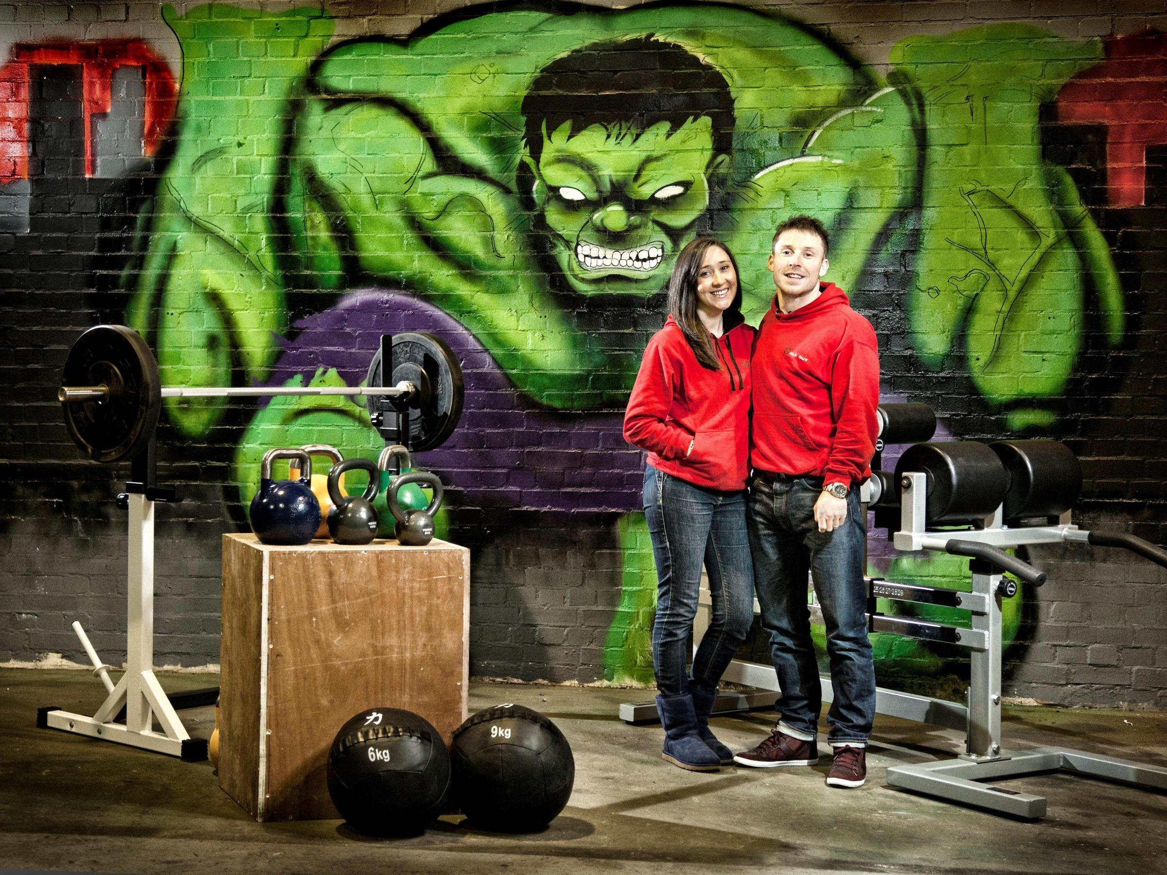 Vikki and Terry Anderson at CrossFit All Out, their new fitness venture in Newton Aycliffe. Graffiti art by Dan Walls and Oxo. Photo by Eye Dream Photography