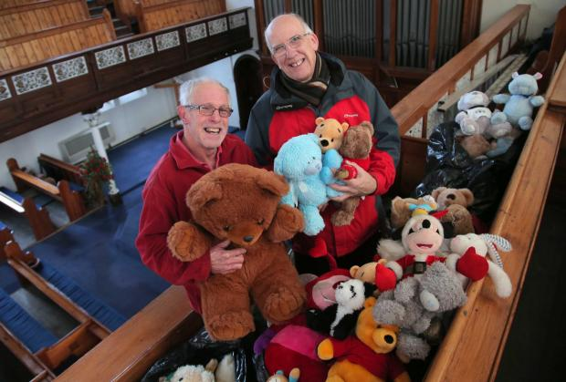 Teddy enthusiast Dave Ward, left, hands over the toys from the Danny Wake street tributes to Peter King, deacon of Grange Road Baptist Church in Darlington
