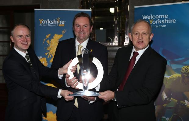 Tom Riordan, chief executive of Leeds City Council, Gary Verity, chief executive of Welcome to Yorkshire and Keith Wakefield, Leader of Leeds City Council with The Official trophy for the Tour de France Grand Depart as it goes on public display