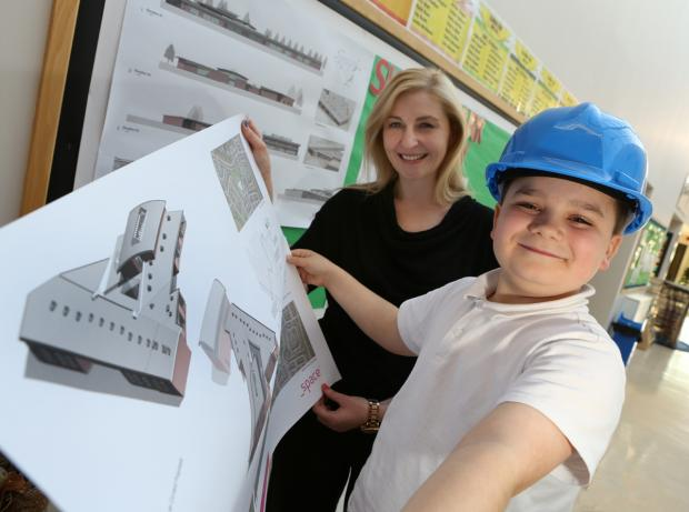 Skerne Park Academy pupil Thomas Dillon with head teacher Kate Chisholm.