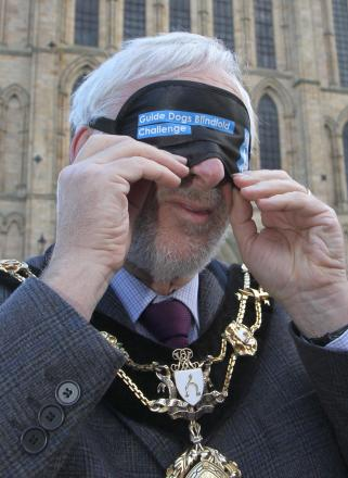 The Mayor of Ripon, Coun Mick Stanley undertaking a blindfold walk