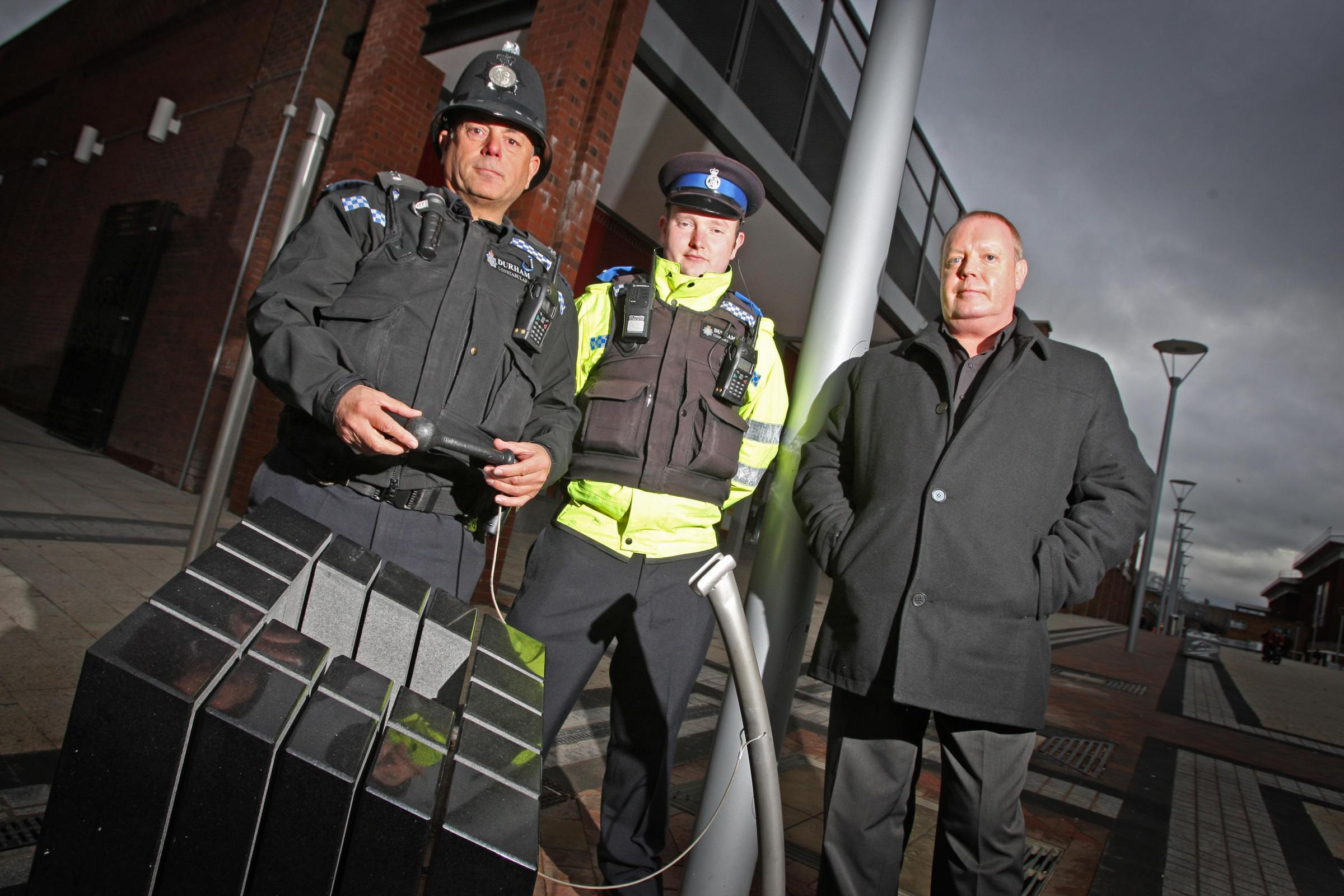 Vandals have caused thousands of pounds-worth of damage to a sculpture that forms part of the £2m revamp of Newton Aycliffe. Pictured with the damaged sculpture are, (L to R), PC Keith Todd, PCSO Gavin Laycock and town centre manager Bryan Haldane