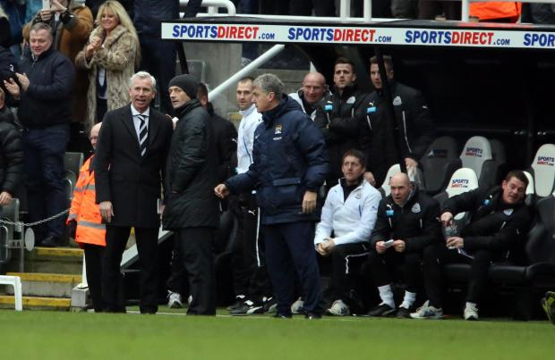 CONTROVERSIAL DECISION: Newcastle manager Alan Pardew consults the fourth official after Cheik Tiote's stunning effort was ruled offside, while Manchester City assistant manager Brian Kidd, looks on