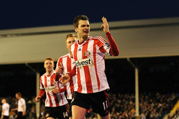 HAT-TRICK HERO: Adam Johnson, the Sunderland winger, celebrates after scoring his third goal at Craven Cottage, a first hat-trick for the former Middlesbrough prospect