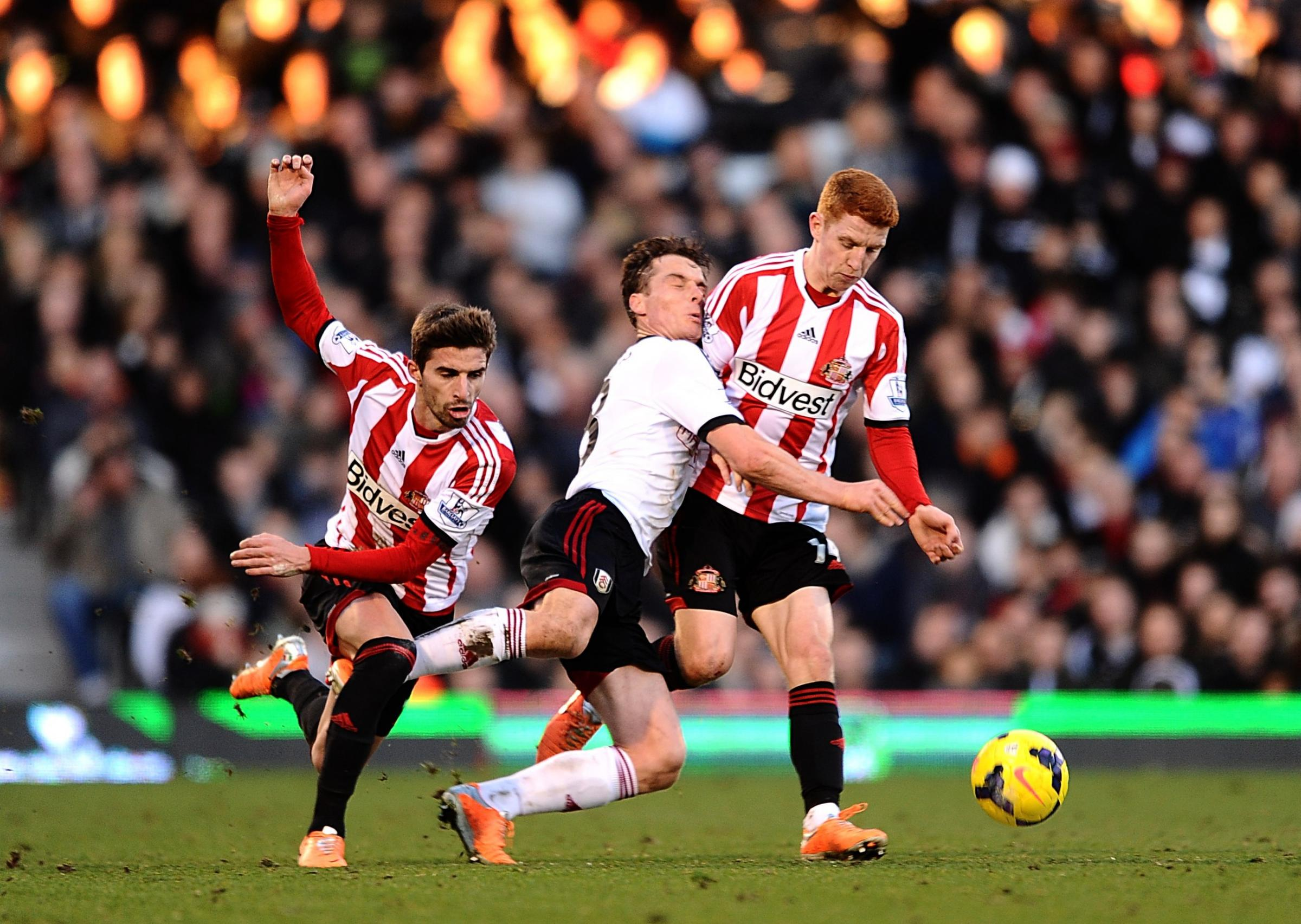BRUSHED OFF: Jack Colback (right) wins a challenge with Fulham's Scott Parker