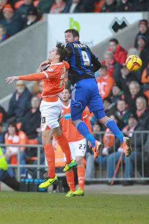 AERIAL BATTLE: Lucas Jutkiewicz and Blackpool's Craig Cathcart contest a header