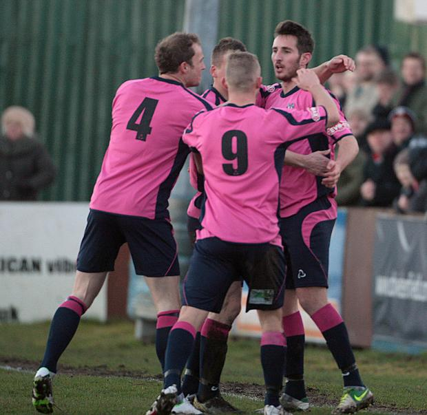 WELCOME RETURN: Joe Tait is congratulated after scoring eight minutes into his return to Quakers last Saturday
