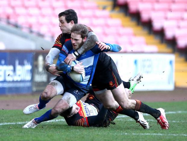 UNDER PRESSURE: Mowden full back Chris McTurk is tackled by both Harrogate's Stephen Parsons (top) and Joe Rowntree