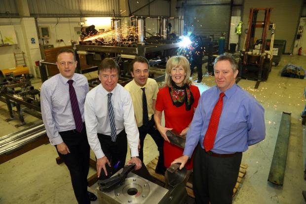 Pictured from left to right are David Lander, from Natwest, Neville Baldry, of Clive Owen and Co, and John Horn, Julie Bates and Brian Bates from Lamba Welding Systems
