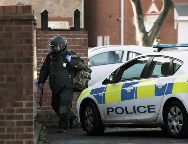 An army bomb disposal officer makes his way into the house on St George's Road, Grangetown