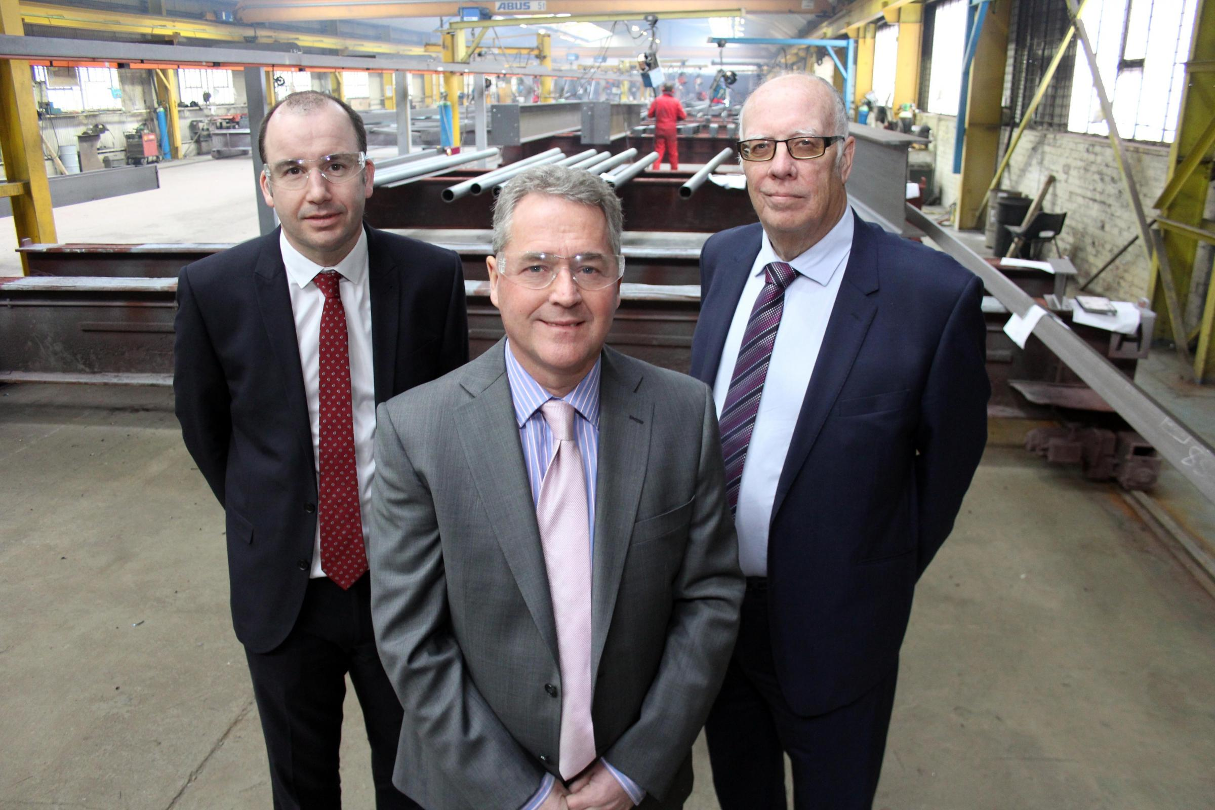 Major contract: John Finley (centre), Shepherd Construction project manager Neil Matthias (left) and Merchant Place Developments director Geoff Hunton.