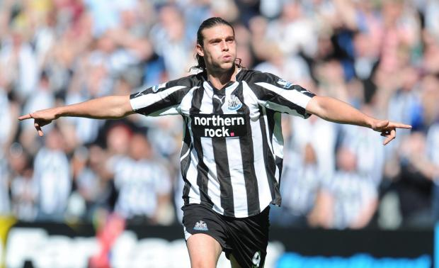 HOMETOWN HERO: Carroll celebrates a goal during his days on Tyneside as Newcastle United's No. 9