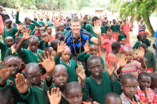 Steve Cram with Maasai school children at the village of Olorte where COCO have funded the construction of a classroom at a primary school.