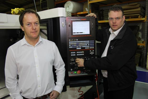 ALM's new production manager Tim Walker (left) and production engineer John Blackburn with the firm's new £160,000 lathe machine.