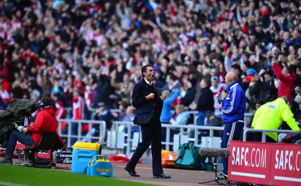 PRIDE AND PASSION: Sunderland boss Gus Poyet undersrands the special bond between the club's supporters and his players - and hopes the backing of 9,000 fans at Old Trafford this evening will help inspire his players to reach the Capital One Cup final