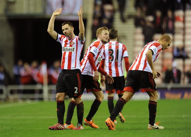 TIME TO CELEBRATE: Phil Bardsley, left, after Ryan Giggs' own goal in the first leg