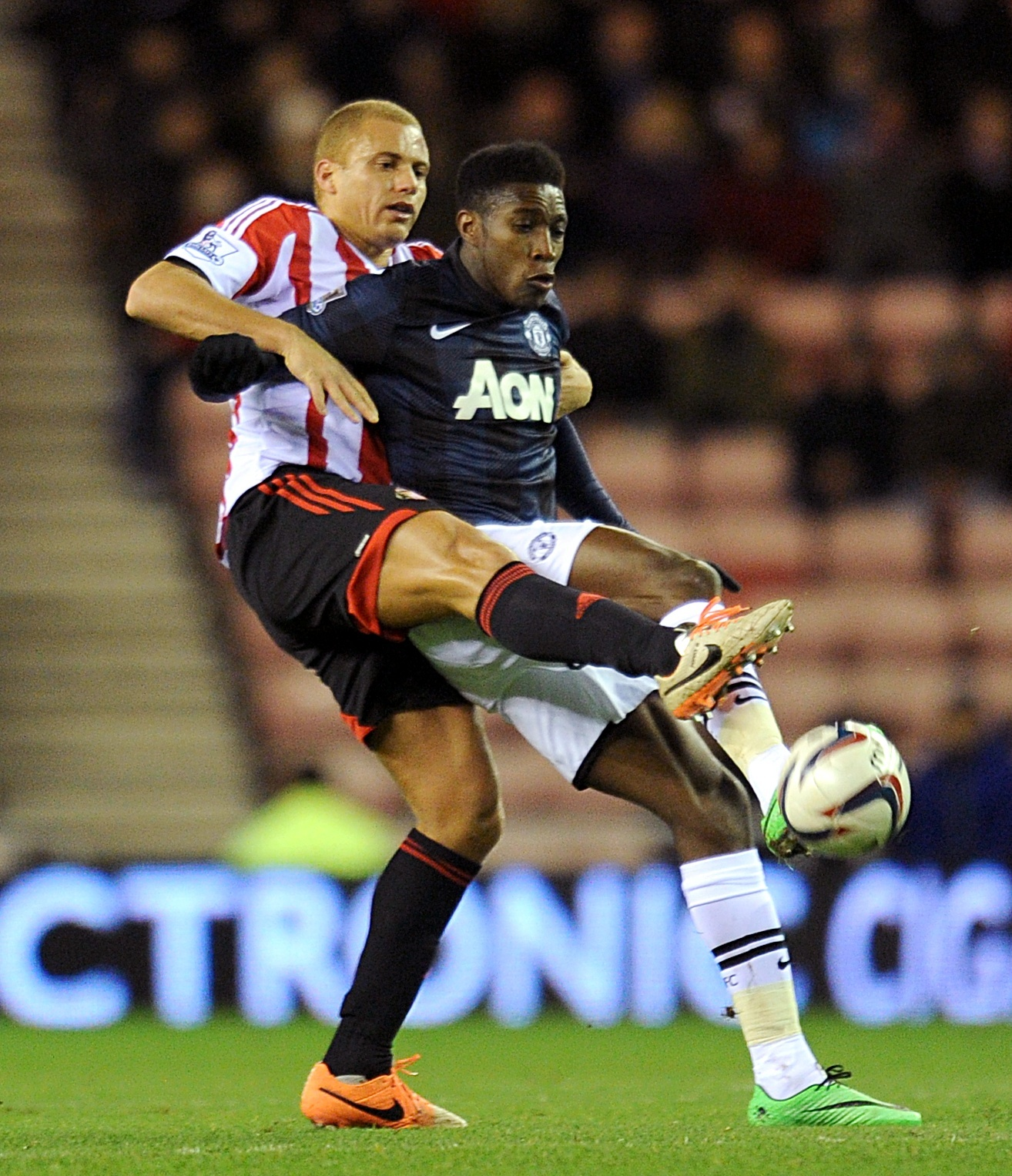 LIFE BEGINS AT 40: Wes Brown, left, tussles with Danny Welbeck during the first leg of the Capital One Cup semi-final two weeks ago. Poyet says the defender could play into his 40s