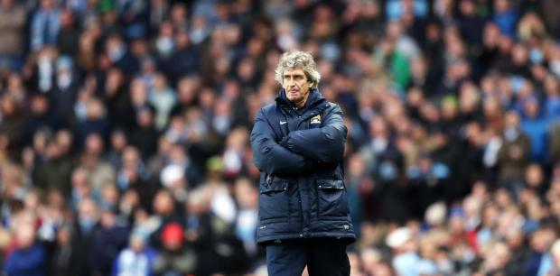TROPHY TREBLE: Manuel Pellegrini is hoping to add the FA Cup and Premier League title to the Capital One Cup that Manchester City won yesterday
