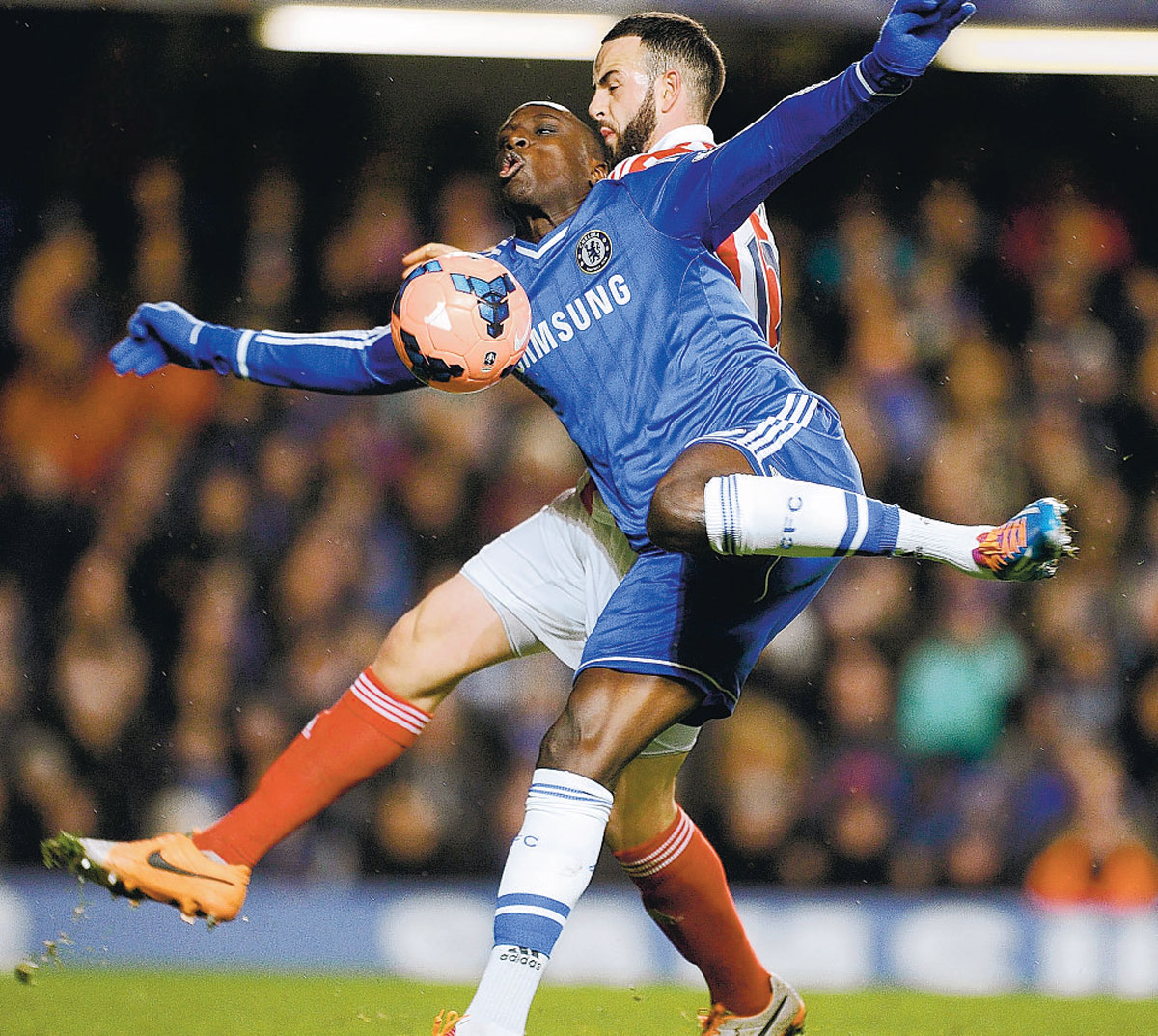 STAR JUMP: Chelsea's Demba Ba in the thick of the action during his side's 1-0 win