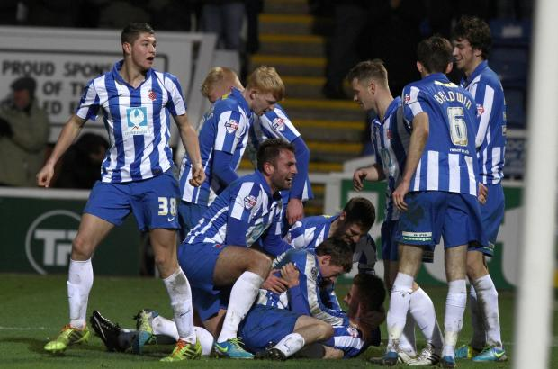 CELEBRATIONS: Pools' players pile on top of Jack Barmby after he put them 2-0 up against visitors York City on Saturday