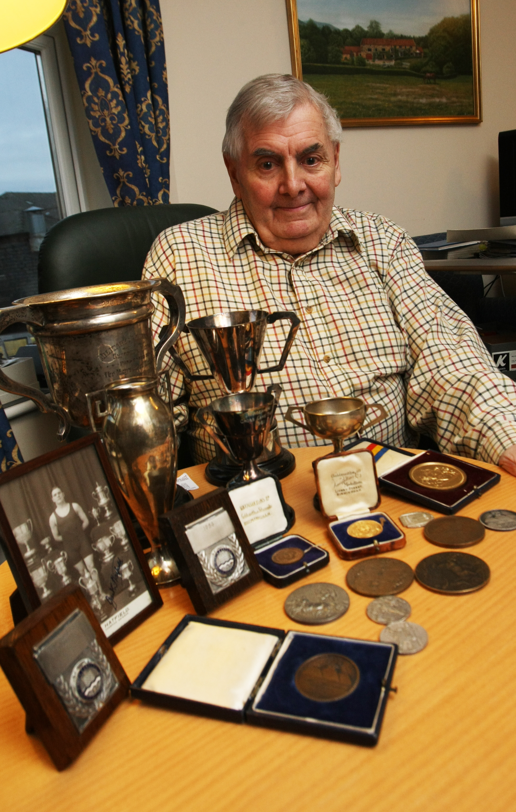 Jack Hatfield with some of the medals he and his father won.